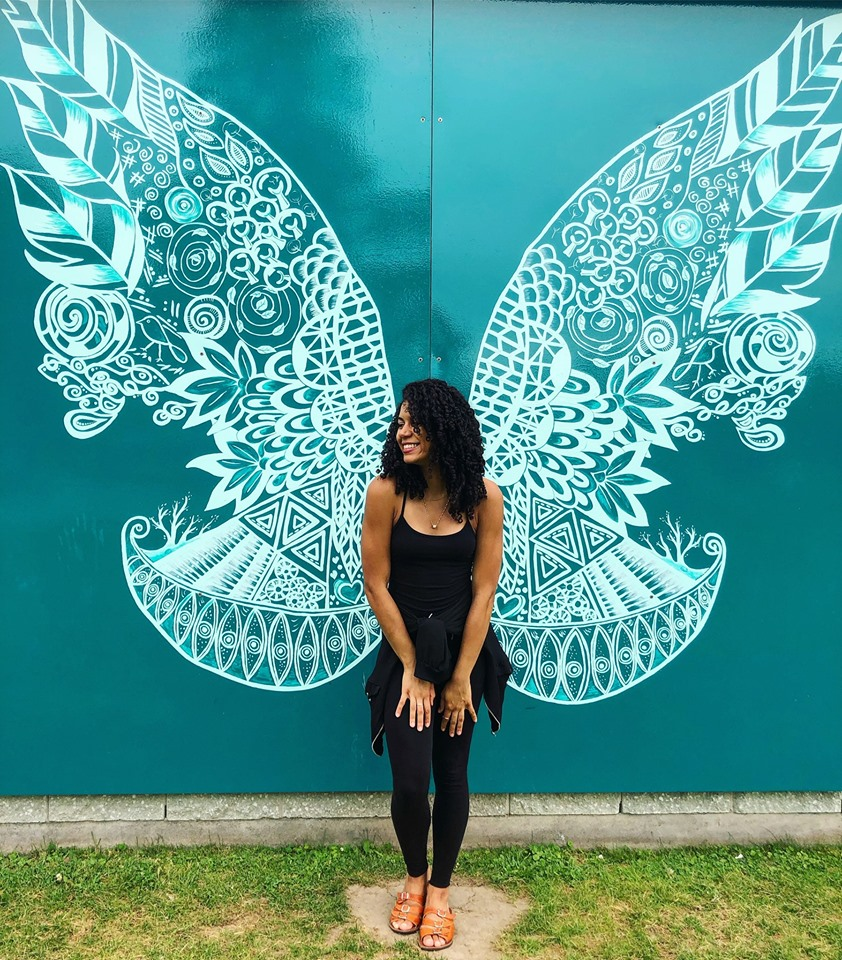 happy girl with wings to fly