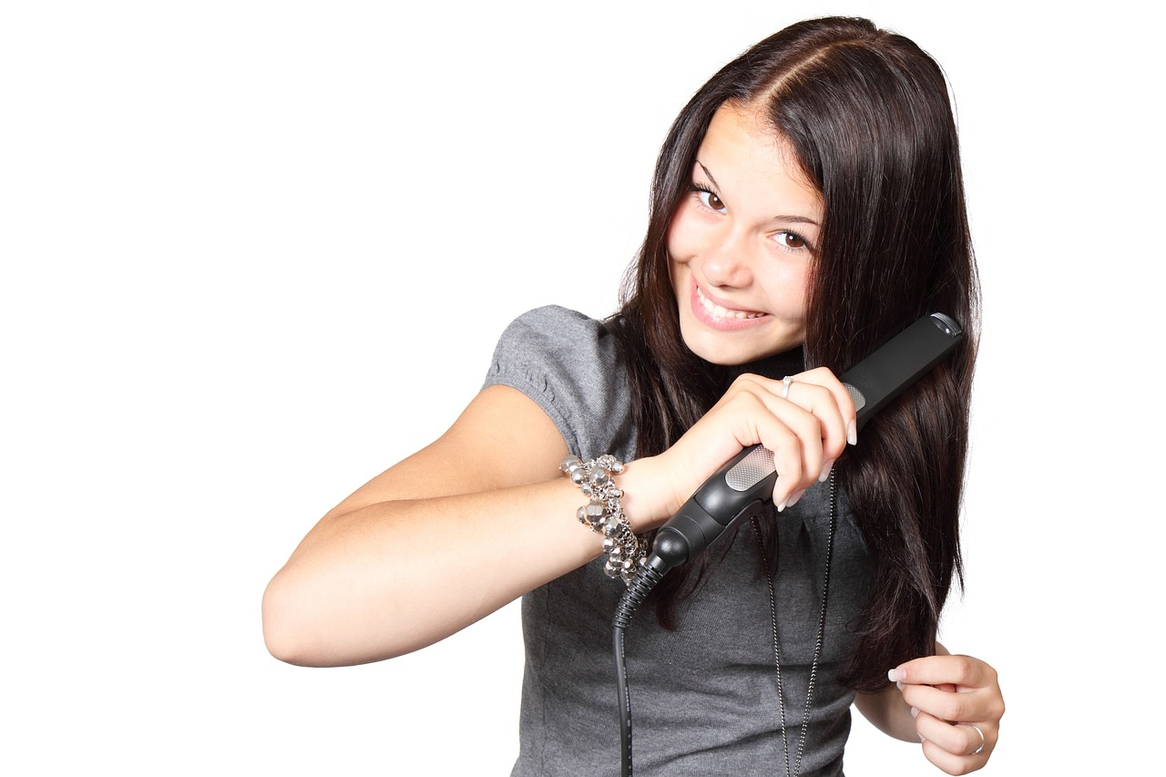 Girl with a hair straightener